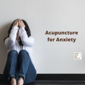 Anxious woman cups her head in her hands