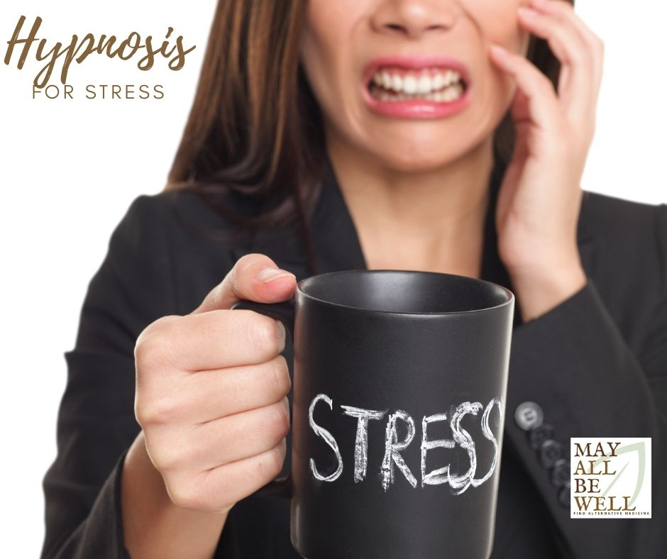 Woman holds a cup with the word 'stress' written on it while cringing.